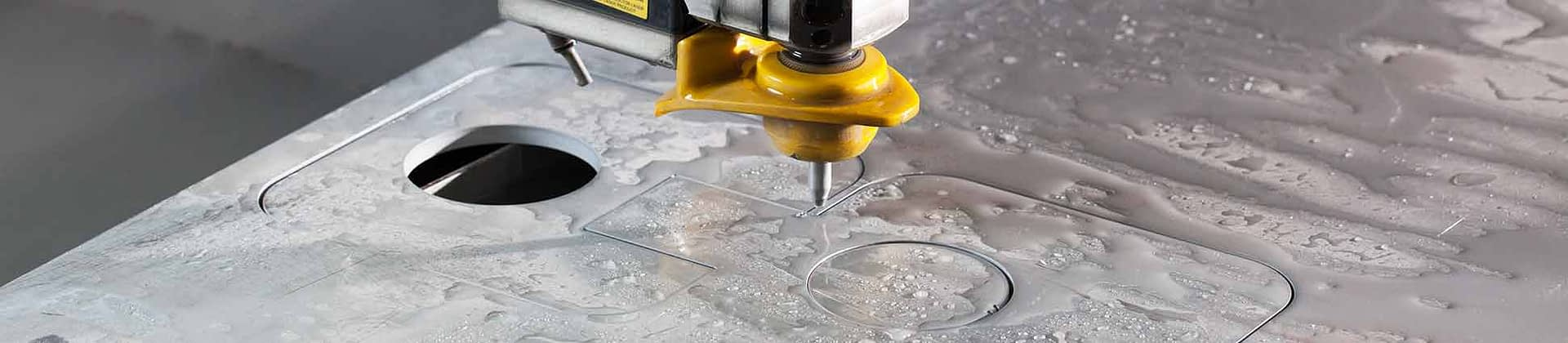 Water jet cutting of metal