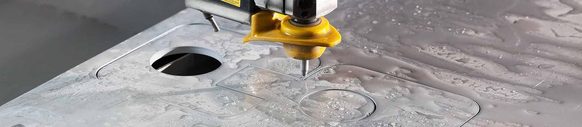 Water jet cutting of metal